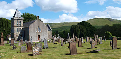 Straiton village church with the Inkerman memorial on Glengower hilltop behind